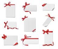 Saluto di celebrazione di chirstmas della nota della carta dell'arco del nastro Immagini Stock