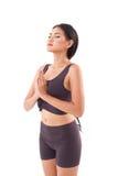 Saluto di pratica del sole di yoga della donna attiva Immagine Stock