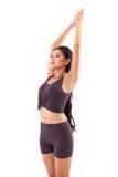 Saluto di pratica del sole di yoga della donna attiva, allungante esercizio Fotografia Stock