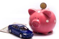 Salvadanaio, soldi ed automobile Fotografie Stock Libere da Diritti