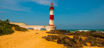 SALVADOR, BAHIA, BRAZIL: Farol De Itapua on the rough sea. Lighthouse on the beach in Sunny weather. SALVADOR, BAHIA, BRAZIL:Farol De Itapua on the rough sea royalty free stock image