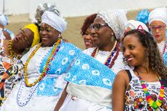 Carnival celebration at Pelourinho in Salvador Bahia, Brazil. Salvador Bahia, Brazil - February 12th, 2018: A female reveler taking a photo with two women Royalty Free Stock Photography