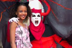 Carnival celebration at Pelourinho in Salvador Bahia, Brazil. Salvador Bahia, Brazil - February 12th, 2018: A girl is takiing a photo with a reveler with Devil Royalty Free Stock Images