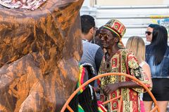 Carnival hat vendor on the streets in Salvador Bahia on carnival. Salvador Bahia, Brazil - February 11th, 2018: A street carnival hats vendor selling colorful Royalty Free Stock Images
