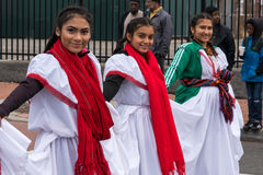 Salvadorian Girls in Native Dress. Washington, DC - January 16, 2017: Three Salvadorian girls wearing native outfits participate in the annual Martin Luther King royalty free stock image