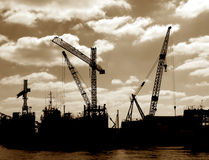 Salvage Boat Cranes in Port Busy Harbor Shipyard Royalty Free Stock Photography