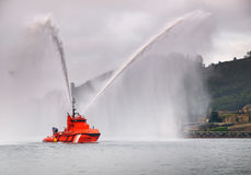 Salvage tugboat. With two big water jets in the Ferrol estuary Stock Photos