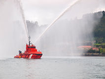 Salvage tugboat with two big water jets. Salvage tugboat with two big water jets in the Ferrol estuary Stock Photo