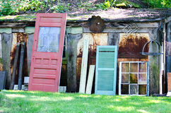 Salvage yard with old doors and windows Stock Photos