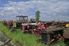 Salvaged tractors fill up a junkyard Stock Images