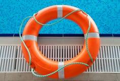 Salvamento na piscina Foto de Stock Royalty Free