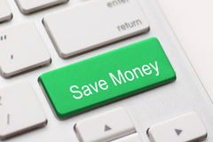 Salvar a chave do botão do dinheiro Foto de Stock