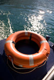 Salvation. A bright orange lifebuoy on a boat Royalty Free Stock Photos