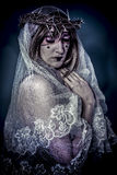 Salvation, aith concept, woman dressed in white veil and crown o Royalty Free Stock Image