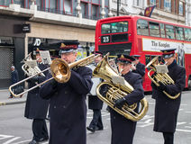 Salvation Army brass band in London. Salvation Army brass band orchestra singing on the street in London, United Kingdom Royalty Free Stock Photos