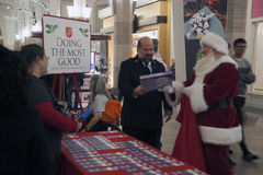 Salvation Army Giving Tree. The Salvation Army, Tacoma Washington Corps Officer accepts gifts from Santa Clause at the Giving Tree Kick-Off at Tacoma Mall on stock photography
