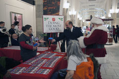 Salvation Army Giving Tree. The Salvation Army, Tacoma Washington Corps Officer accepts gifts from Santa Clause at the Giving Tree Kick-Off at Tacoma Mall on stock image