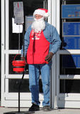 Salvation Army Santa Clause. Collecting charitable donations for the homeless and needy at a local Wal-Mart in Los Lunas, NM on Christmas Eve 2011 Stock Image
