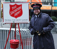 Salvation Army soldier perform for collections in midtown Manhattan Stock Image