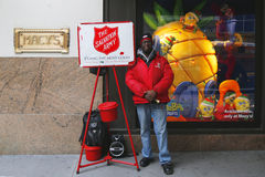 Salvation Army soldier performs for collections Stock Images