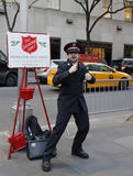 Salvation Army soldier performs for collections Royalty Free Stock Image