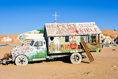 Salvation Mountain Painted Truck. Painted truck in front of Salvation Mountain.  The truck has the words Repent, Bible, God is Love, and other writings on it Stock Photography