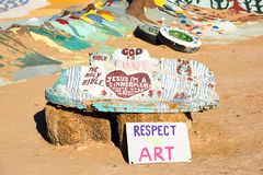 Salvation Mountain - Respect The Art. Art monument created on top of hay bales, located on the grounds of Salvation Mountain. Painted words include: God is Love Stock Image