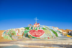 Salvation Mountain. Is a tribute to God and was created by Leonard Knight as a gift to the work expressing the statement, `God is love` boldly painted at the Royalty Free Stock Images