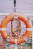 Salvavidas en el embarcadero del transbordador Imagen de archivo libre de regalías