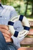 Salvavidas o flotador; concepto para cruzar, navegar o el trabajo en equipo Foto de archivo