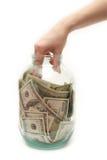 Salve el dinero en la batería Foto de archivo