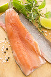 Salvelinus Fillet on Wooden Plate royalty free stock images