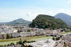 Salzach river flows through Salzburg city centre in Austria Stock Images
