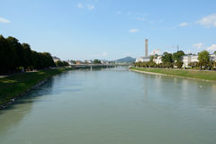 Salzach river and some buildings in Salzburg, Austria. Salzburg, Austria - September 1, 2015: Salzach river and some buildings in Salzburg in Austria Royalty Free Stock Image