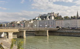 Salzach river, Staatsbrucke bridge and fortress in Salzburg, Austria Stock Images
