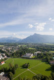 Salzburg and the Alps. The beautiful panoramic view of the Salzburg city, Austria, in front of the Alps Royalty Free Stock Photography