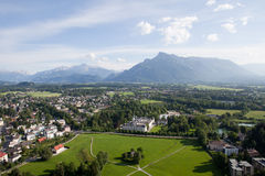 Salzburg and the Alps. The beautiful panoramic view of the Salzburg city, Austria, in front of the Alps Stock Images