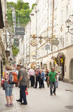 Salzburg, Austria. Sigmund Haffner Grasse (street) in Salzburg.These streets are the commercial center of Salzburg city, closely guarded by the tall tower of the Royalty Free Stock Photos