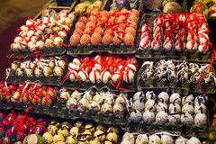 A lot of christmas balls in the shop window. Royalty Free Stock Images