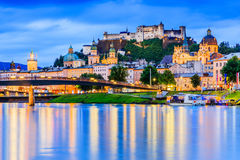 Salzburg, Austria. Festung Hohensalzburg fortress, Salzburger Dom and Salzach river at twilight Royalty Free Stock Image