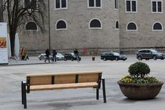 Salzburg, Austria - March 19, 2013: View of the streets of Salzburg in winter. empty bench stock photography