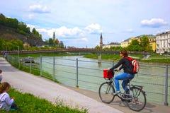 Free Salzburg, Austria - May 01, 2017: Cyclist On The Embankment In Salzburg Stock Photo - 97440310