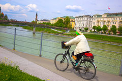 Salzburg, Austria - May 01, 2017: Cyclist on the embankment in Salzburg royalty free stock photography