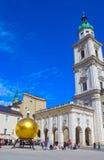 Salzburg, Austria - May 01, 2017: The golden ball statue with a man on the top sculpture, Kapitelplatz Square, Salzburg, Royalty Free Stock Photo