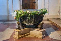 Baptismal font in which composer Wolfgang Amadeus Mozart was baptized. Interior of Salzburg Cathedral or Salzburger Dom is baroque stock image