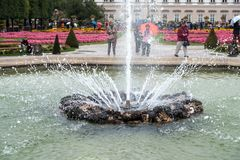 SALZBURG/AUSTRIA - SEPTEMBER 19 :Fountain in the Mirabelle Gardens in Salzburg in Austria on September 19, 2017. Unidentified. People royalty free stock image