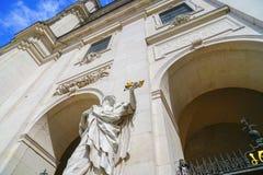 Statue of mediaval man holding keys aloft outside Salzburg Cathedral. SALZBURG AUSTRIA - SEPTEMBER 6 2017; Statue of mediaval man holding keys , including one royalty free stock photos