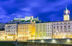 Urban night light glow across Salzach River Stock Photos