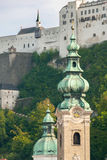 Salzburg Castle framed by church towers III Stock Images