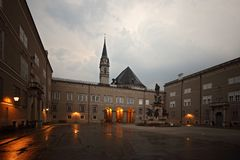 Salzburg Domplatz twilight view to the Franziskanerkirche. Salzburg Domplatz Cathedral Square twilight view to the Franziskanerkirche royalty free stock images